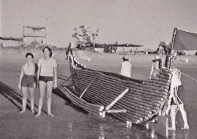 Beer can regatta, 1979. Launching a beer can boat in the water.