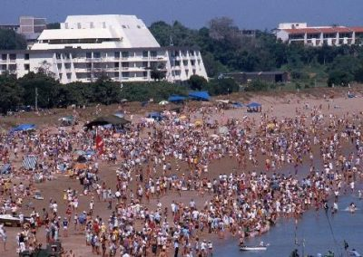 Spectators on the beach at the annual Beer Can Regatta. In the background is the Diamond Beach Casino 1984